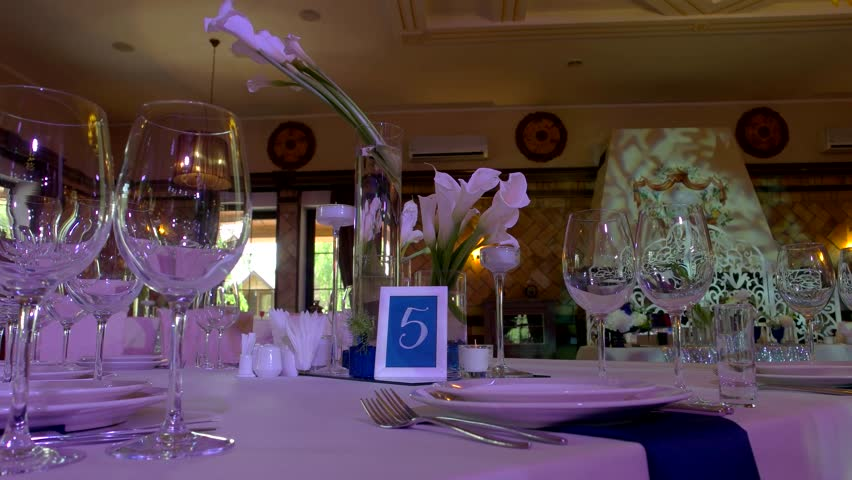 table in restaurant dishes and empty wineglasses banquet in expensive place 4k - Violet Cafe 2015