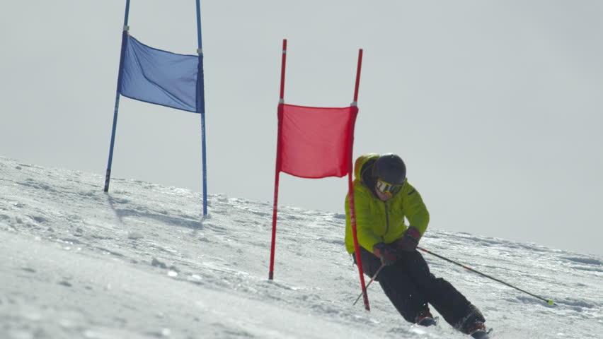 SLOW MOTION: Slalom skier skiing between the gates