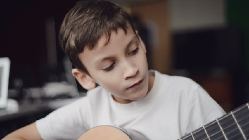 boy play guitar