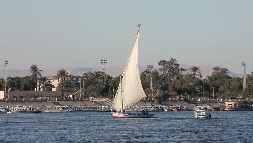 EGYPT, LUXOR - JANUARY 2013: Felucca & Passenger Ferry; River Nile Luxor Egypt