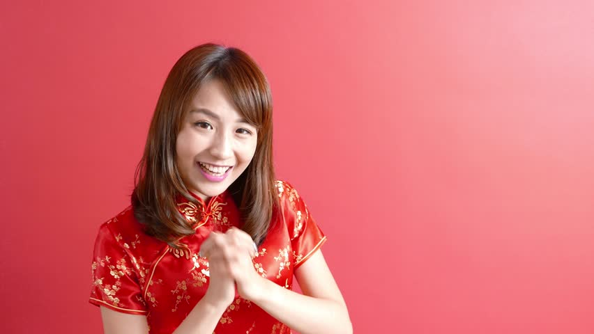 video of beauty woman wear cheongsam and smile to you in chinese new year