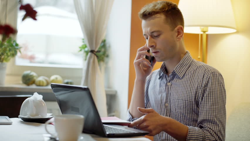 Man looks busy while talking on cellphone about outcomes