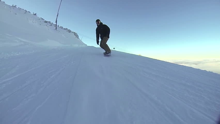 Snowboarder carving on cat track with backside slash | Shutterstock HD Video #22437919