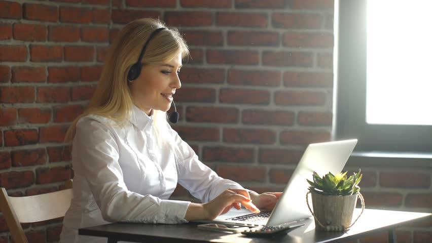 Closeup of a beautiful blonde business customer service woman   Shutterstock HD Video #22448449