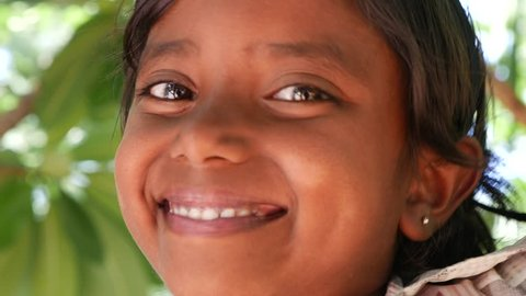 Girl from a small village smiling in India