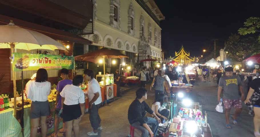 CHIANG MAI,THAILAND - October 2016: Chiang Mai night street market stalls in central old town with old buildings