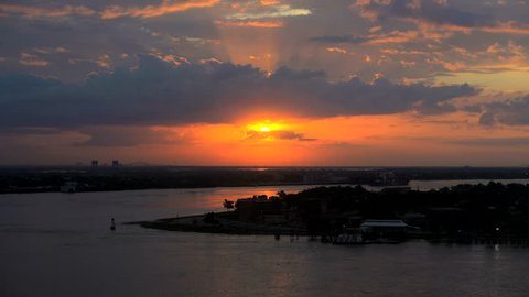 Time lapse view of Mississippi River at sunset with commercial and Cruise ships passing New Orleans Louisiana America