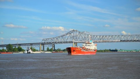 New Orleans, USA - September 2016: Commercial ship by Crescent City Connection Bridge on the Mississippi River New Orleans Louisiana