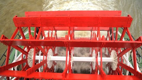 View of Steam River Boat with Paddle wheels rotating along the Mississippi River New Orleans Louisiana USA America