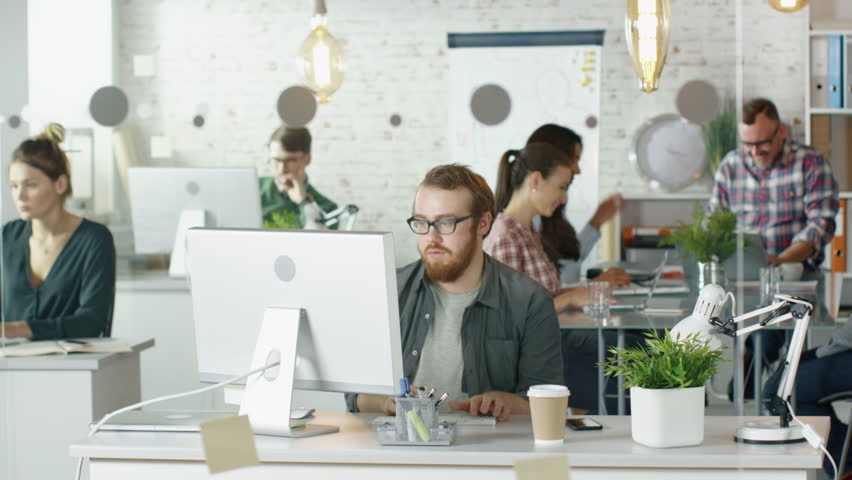 Life of a Busy Creative Bureau. People Solving Problems, Attending Conferences, Working On their Personal Computers and discussion Work Related Matters.  Shot on RED EPIC (uhd).   Shutterstock HD Video #22521109