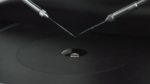 Macro shot of micromanipulator pipette set up, preparation needles for icsi ivf procedure
