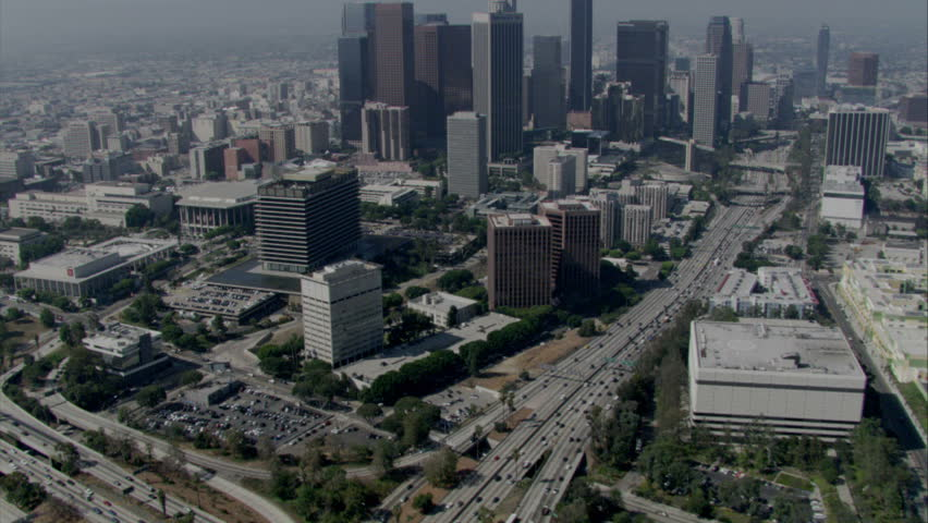 aerial daytime shot of Los Angeles with major freeway and traffic circa 2009