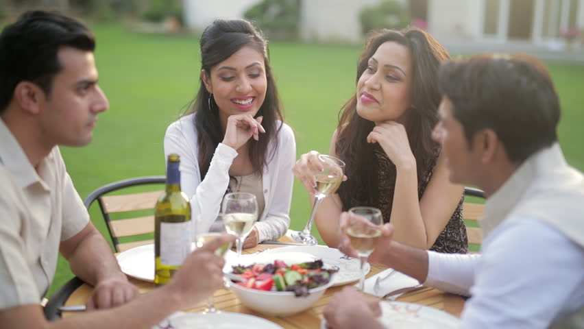 MS SELECTIVE FOCUS Couples talking during dinner in backyard / India | Shutterstock HD Video #22533598