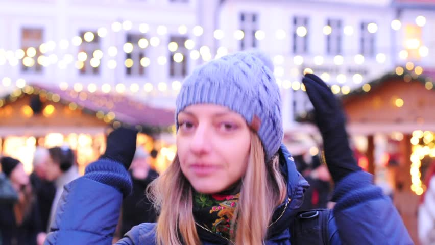Happy tourist woman in Tallin, Estonia, selective focus video