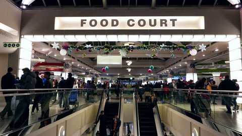 Burnaby, BC, Canada - December 23, 2016 : One side of people having dinner at food court area inside Burnaby shopping mall with 4k resolution.