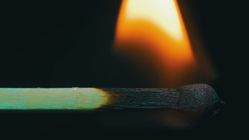 Burning Match And Flame. Safety Match close-up on a black background spectacularly burning fire and burns until the end leaving behind a charred wood matches. High quality, Full HD 1920 x 1080p, 29