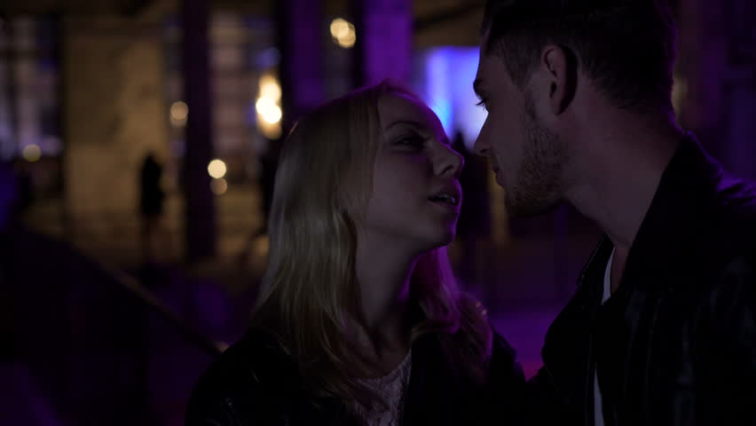 kids watching tv at night. attractive woman flirting with man on the street near night club, pick-up - kids watching tv at