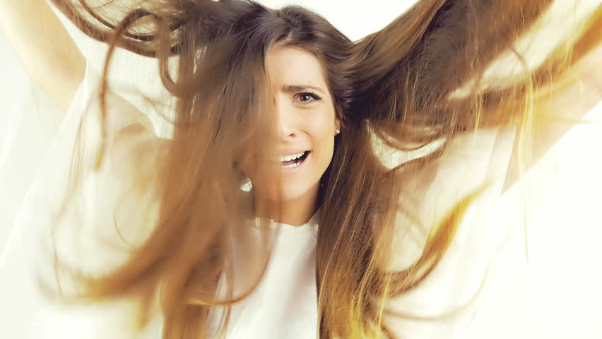 Beautiful woman screaming for ruined hair with split ends slow motion isolate