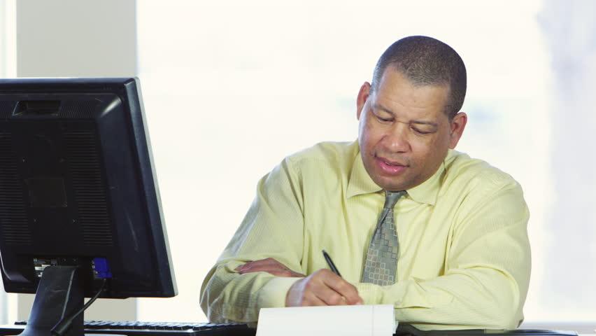 Business man writing letter at work | Shutterstock HD Video #22641319