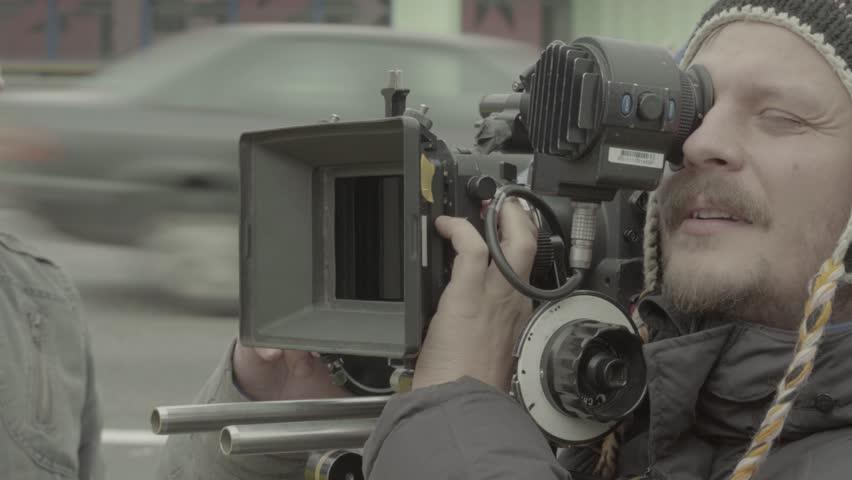 KYIV, UKRAINE  –  NOVEMBER 18, 2016. Man the cameraman shoots the movie   Shutterstock HD Video #22657810