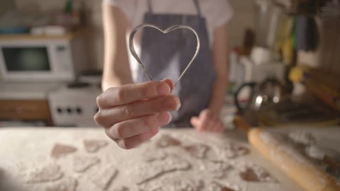 girl cooks biscuits for Valentines Day