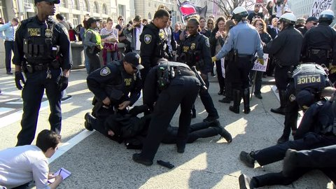 A protestor is arrested after a fight breaks out between a protestors and a National Policy Institute conference attendee Nov. 19, 2016 in Washington, DC. A legal worker takes his name.