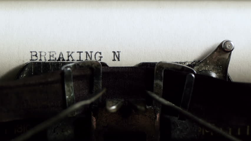 Typing Breaking News (HD). Breaking News being typed and centered on Vintage 1940s typewriter. Ambient audio Included.