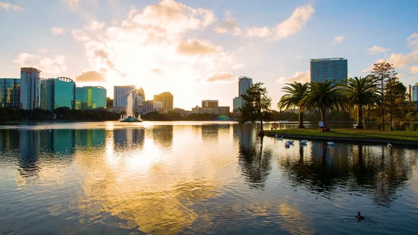 Sunset over the Eola lake timelapse, Eola Park, Orlando, Florida USA