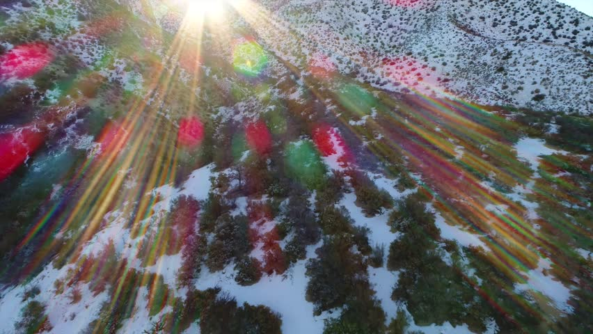 Breathtaking aerial video of Snowy Mountains with Lens Flare (4k)