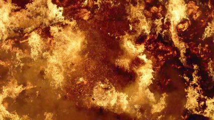 Fire storm, horrific fire destroys gigantic hay bales construction, Red Epic slow motion clip