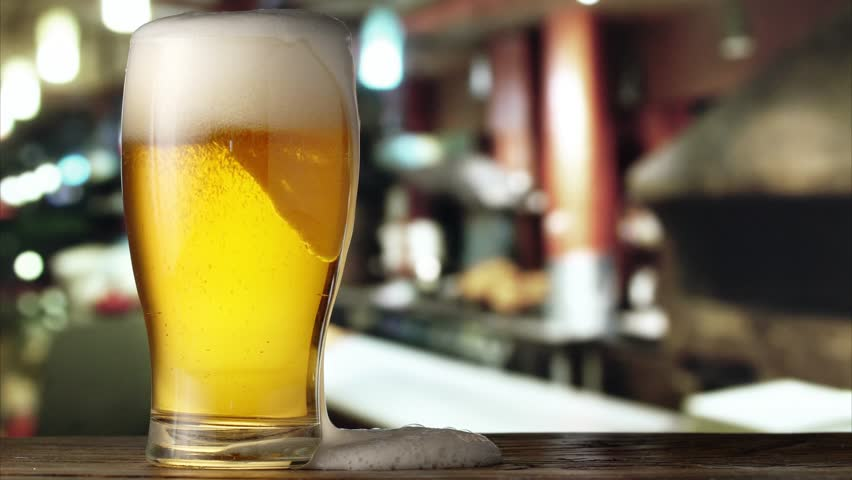 Beer is pouring from the top into the glass. 4K video. | Shutterstock HD Video #22811719