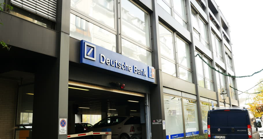 "BADEN-BADEN, GERMANY - CIRCA, 2014: Deutsche Bank AG - literally ""German Bank"" on a quiet German street. Deutsche Bank is a German global banking and financial services company."