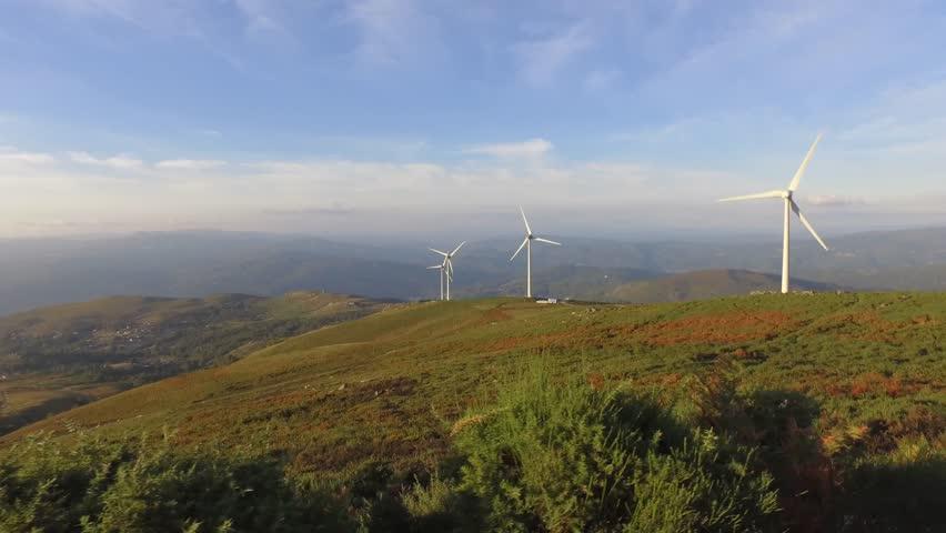 Eolic turbine wind renewable energy farm on top of mountain steady shot 4k | Shutterstock HD Video #22825639