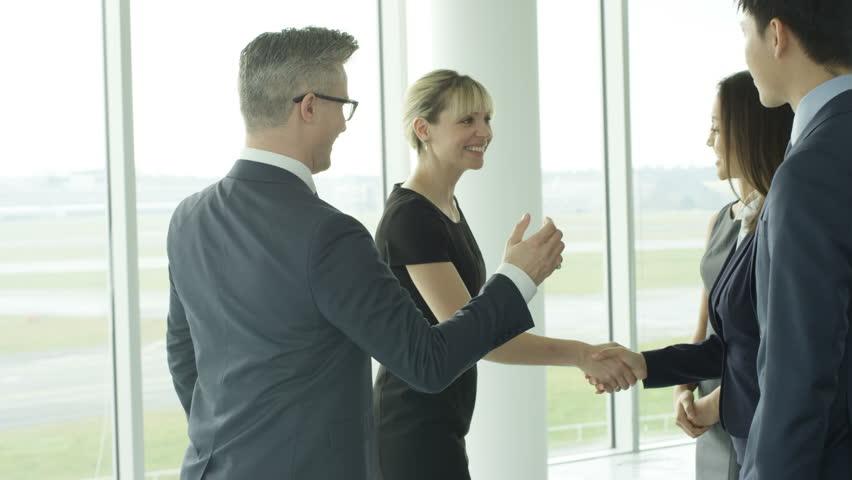 4K Business teams meet & shake hands in large modern office building Dec 2016-UK | Shutterstock HD Video #22829059