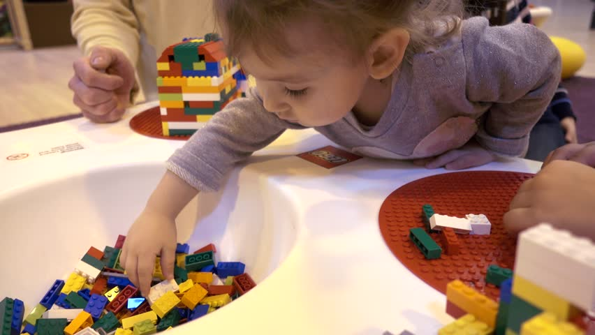 ODESA, UKRAINE - JANUARY 05, 2017: Children kids playing with Lego construction blocks