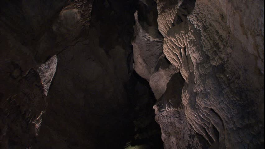Cave passage and dripping stalactites