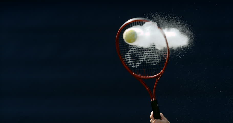 4K Close up in super slowmo, tennis ball suspended in mid air before being hit Dec 2016-UK | Shutterstock HD Video #22960399