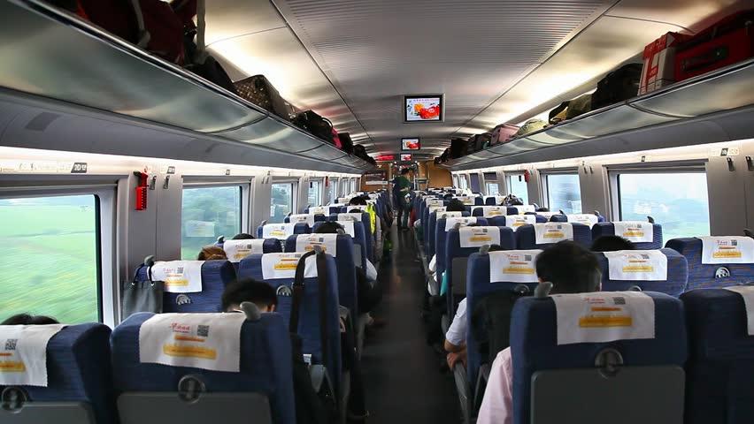 BEIJING, CHINA - SEPTEMBER 27, 2014: Passengers inside of a bullet train on September 27, 2014 in Beijing, China | Shutterstock HD Video #22971574