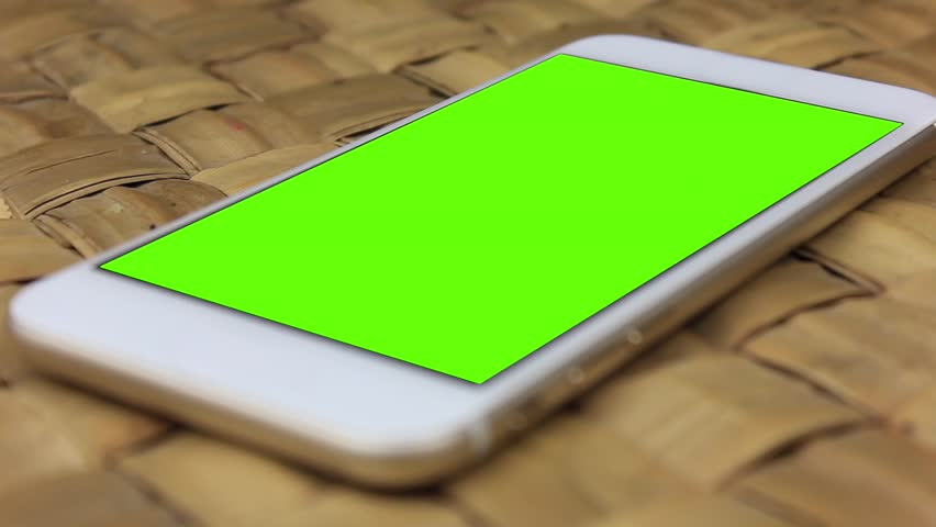 White Smartphone Laid On The Stock Footage Video 100 Royalty Free