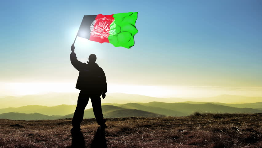 Successful silhouette man winner waving Afganistan flag on top of the mountain peak, Cinemagraph LOOP background