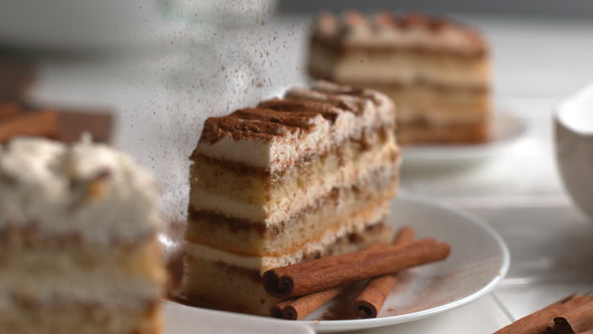 Cinnamon sprinkled onto Tiramisu cake in super slow motion, shot on Phantom Flex 4K