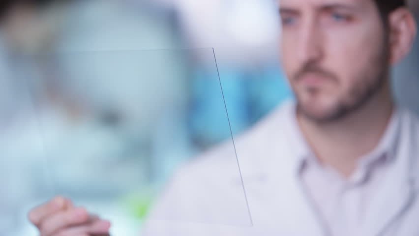 4K Scientist holding piece of clear material & using as interactive touch screen Dec 2016-UK | Shutterstock HD Video #23023459