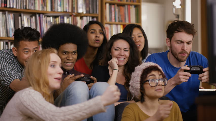 4K Large group of happy young friends playing video games at home Dec 2016-UK | Shutterstock HD Video #23024329