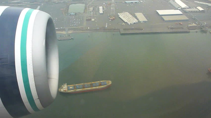 Flying in airplane over Portland, Oregon and the Columbia River with large