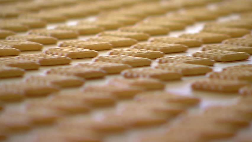 The many cookies on the tape moves in the candy factory. Close-up. #23091694