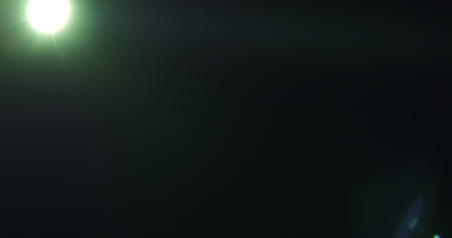 Green lens flare artifacts over black background for overlay, 4k prores footage   Shutterstock HD Video #23094469