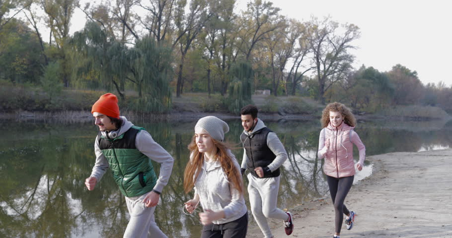 Six Half-Naked Young Men Run In Forest Near Lake At Autumn Filmati E Video Darchivio -6886