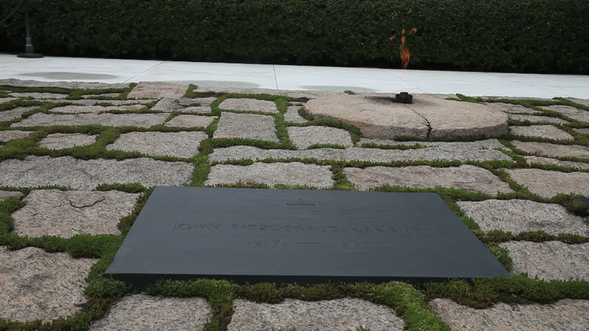 Arlington, Virginia - Circa 2009: The Arlington National Cemetery in 2009. The JFK Tombstone with eternal flame in the background in Arlington, Virgina.