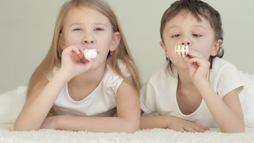 Lovely children lying in bed at home  Concept of Brother And Sister  Together Forever. Blond Twin Boys Making Very Funny Faces While Brushing Teeth In
