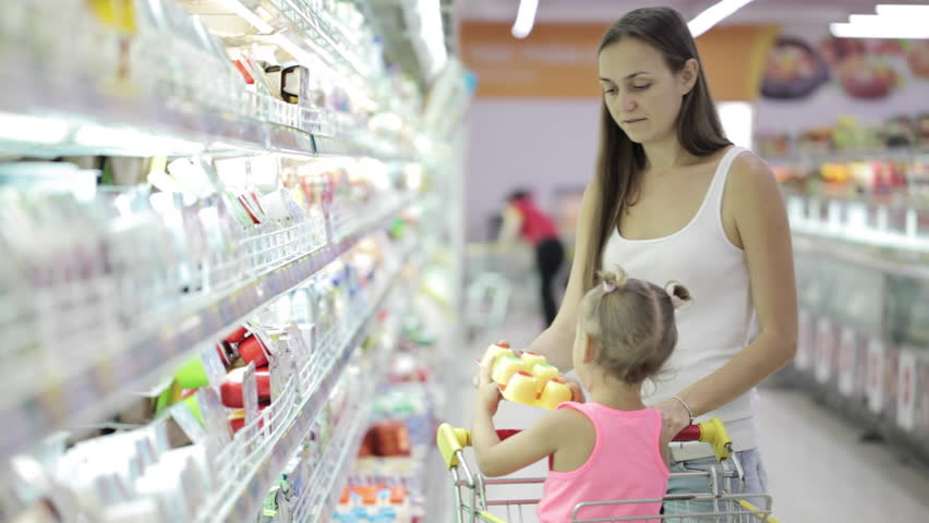 Young attractive woman with cute daughter in shopping cart choosing a yogurt in grocery section at supermarket   Shutterstock HD Video #23156359